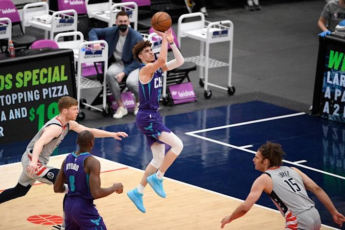 Charlotte Hornets guard LaMelo Ball (2) shoots against Washington Sunday. Ball had eight points in the fourth quarter, but Charlotte ws outscored 36-20 in the period while blowing an 11-point lead.