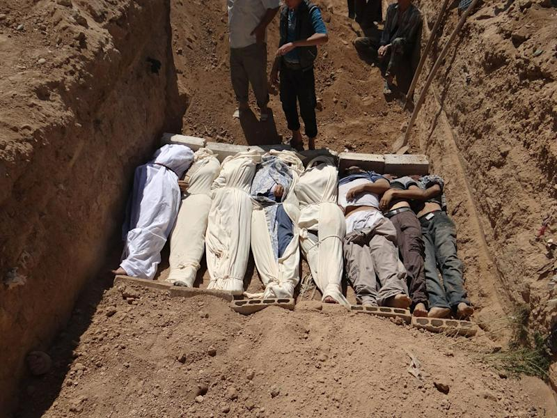 "FILE- This Aug. 21, 2013, file image provided by by Shaam News Network, which has been authenticated based on its contents and other AP reporting, purports to show several bodies being buried during a funeral in a suburb of Damascus, Syria. A senior administration official said Sunday, Aug. 25, 2013, that there is ""very little doubt"" that a chemical weapon was used by the Syrian regime against civilians in an incident that killed at least a hundred people last week, but added that the president had not yet decided how to respond. (AP Photo/Shaam News Network, File)"