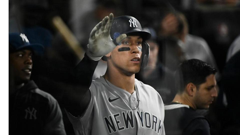 New York Yankees right fielder Aaron Judge (99) in the dugout after he hits a home run during the eighth inning against the Chicago White Sox at Guaranteed Rate Field.