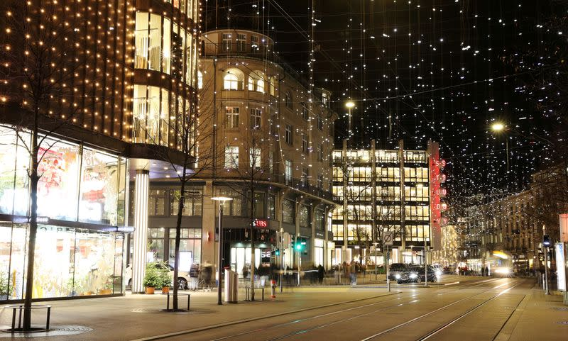 FILE PHOTO: Christmas decorations light up the Bahnhofstrasse shopping street during the continuing coronavirus outbreak in the city centre of Zurich, Switzerland