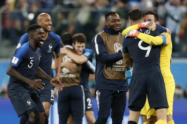 <p>France's Samuel Umtiti, left, celebrates with team mates after the semifinal match between France and Belgium at the 2018 soccer World Cup in the St. Petersburg Stadium in, St. Petersburg, Russia, Tuesday, July 10, 2018. (AP Photo/Frank Augstein) </p>