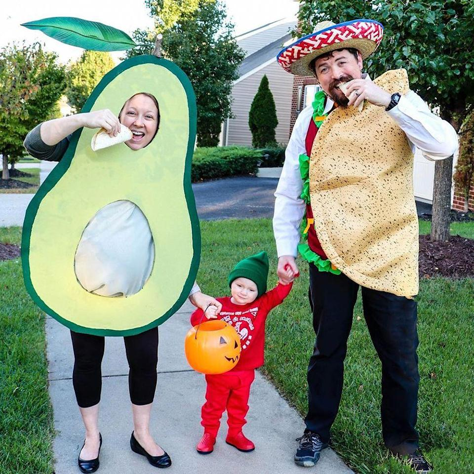 """<p>Taco night is the best night! Also, this little <a href=""""https://www.amazon.com/Sriracha-Chili-Sauce-Tee-small-Heather/dp/B01JPQJS66/?tag=syn-yahoo-20&ascsubtag=%5Bartid%7C2089.g.22530616%5Bsrc%7Cyahoo-us"""" rel=""""nofollow noopener"""" target=""""_blank"""" data-ylk=""""slk:baby Sriracha"""" class=""""link rapid-noclick-resp"""">baby Sriracha</a> is too cute. We love that the <a href=""""https://www.hellowonderful.co/post/easy-diy-avocado-maternity-pregnancy-costume/"""" rel=""""nofollow noopener"""" target=""""_blank"""" data-ylk=""""slk:avocado DIY costume"""" class=""""link rapid-noclick-resp"""">avocado DIY costume</a> is perfect for expecting moms. </p><p><a class=""""link rapid-noclick-resp"""" href=""""https://www.amazon.com/s?k=Taco+Costume&ref=nb_sb_noss&tag=syn-yahoo-20&ascsubtag=%5Bartid%7C2089.g.22530616%5Bsrc%7Cyahoo-us"""" rel=""""nofollow noopener"""" target=""""_blank"""" data-ylk=""""slk:SHOP THE LOOKS"""">SHOP THE LOOKS</a></p><p><strong>Instagram:</strong> <a href=""""https://www.instagram.com/p/B0l54cOAUl6/"""" rel=""""nofollow noopener"""" target=""""_blank"""" data-ylk=""""slk:@savingamyblog"""" class=""""link rapid-noclick-resp"""">@savingamyblog</a></p>"""