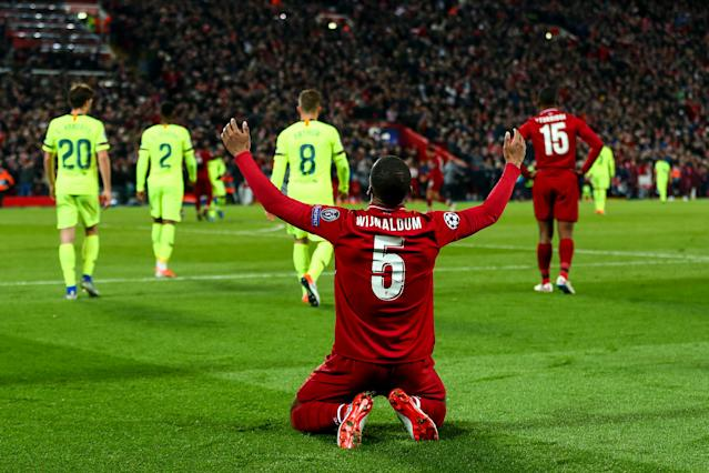 Georginio Wijnaldum of Liverpool celebrates at full time during the UEFA Champions League Semi Final second leg match between Liverpool and Barcelona at Anfield on May 7, 2019 in Liverpool, England. (Photo by Robbie Jay Barratt - AMA/Getty Images)