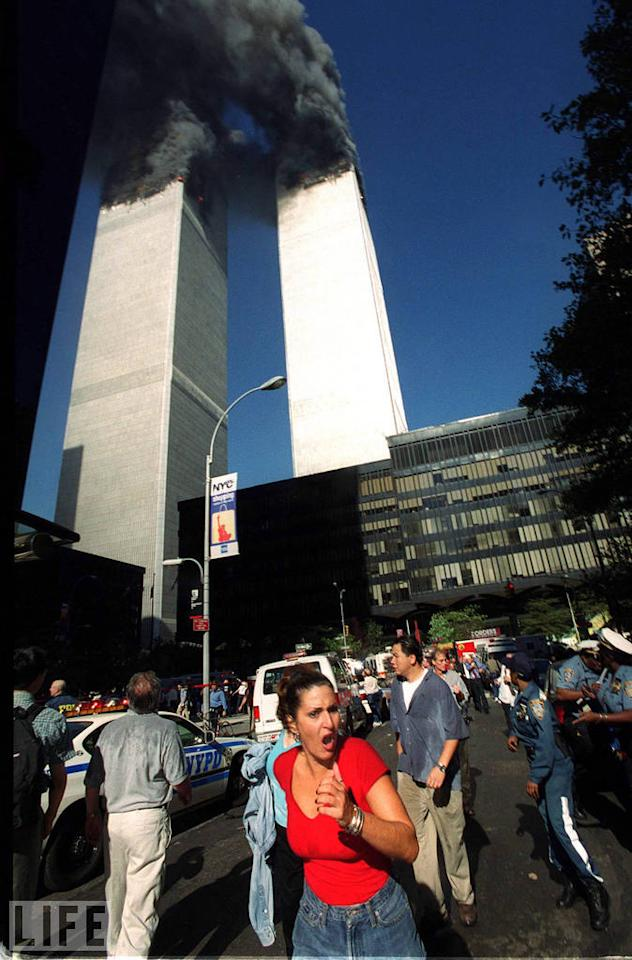"Jennifer S. Altman, a freelance photographer, took this picture of the towers ablaze, and far, far below them, one woman wearing an expression of pure horror. Five years later, Altman was invited to the home of the woman in red, Rose Parascandola, who had been working at an online-trading company on the 51st floor of WTC 1 on September 11. ""She said that I really captured how she felt. She had seen it in the paper, and that it meant a lot to her."" For Altman, it was a meaningful photo, as well. ""It was a turning point in my career. All my skills came together at once in a professional way. But it also made me very aware of my life; I don't take things for granted."" <br><br>(Photo: Jennifer S. Altman/WireImage)<br><br>For the full photo collection, go to <a target=""_blank"" href=""http://www.life.com/gallery/59971/911-the-25-most-powerful-photos#index/0"">LIFE.com</a>"