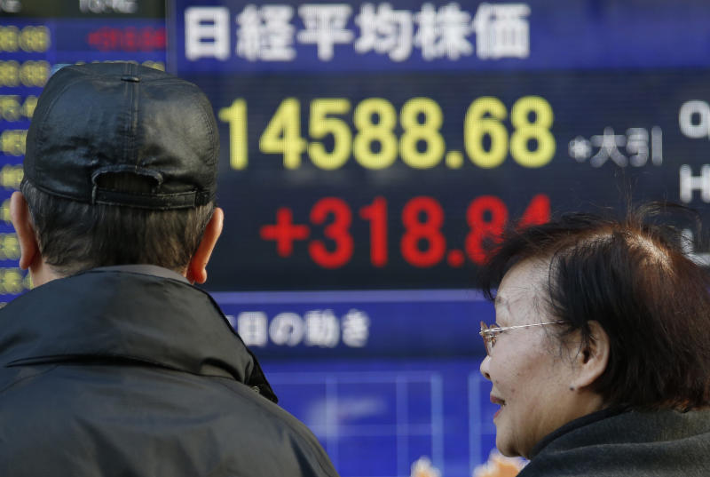 People look at an electronic stock board of a securities firm in Tokyo, Tuesday, Nov. 12, 2013. Asian stock markets mostly traded higher Tuesday after the Dow Jones industrial average hit another all-time high. Tokyo's Nikkei jumped 1.9 percent to 14,534.91. (AP Photo/Koji Sasahara)