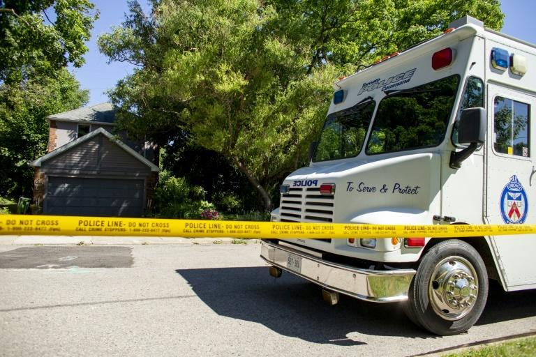 A Toronto Police Command Vehicle sits in July 2018 in front of a home where investigators have discovered human remains in connection with Bruce McArthur, who has pleaded guilty to eight murders