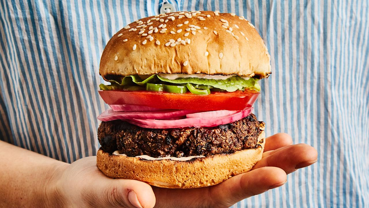 """It sounded like an impossible assignment: a recipe for a from-scratch veggie burger that can go right from the mixing bowl onto the grill without falling apart? Lo and behold, we found a way. <a href=""""https://www.bonappetit.com/recipe/easiest-ever-grilled-veggie-burgers?mbid=synd_yahoo_rss"""">See recipe.</a>"""