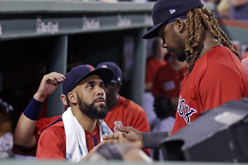 Boston Red Sox starting pitcher David Price, left, congratulates Hanley Ramirez who made the catch on the final out in the fourth inning during a baseball game against the Kansas City Royals at Fenway Park, Friday, July 28, 2017, in Boston. The Red Sox announced that Price was added to the 10-day disabled list prior to the game.