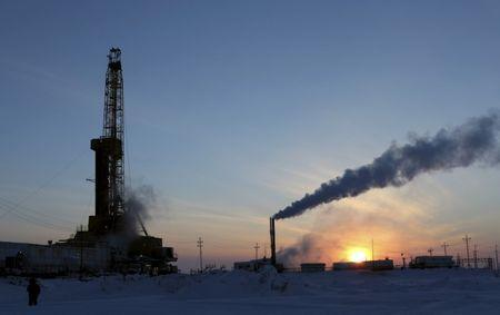 FILE PHOTO:  A view shows an oil derrick and other facilities at Vankorskoye oil field owned by Rosneft company north of Krasnoyarsk