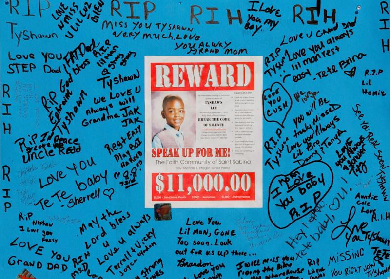 A reward sign and messages hang near the site where Tyshawn Lee was fatally shot in Chicago, on Nov. 4, 2015.