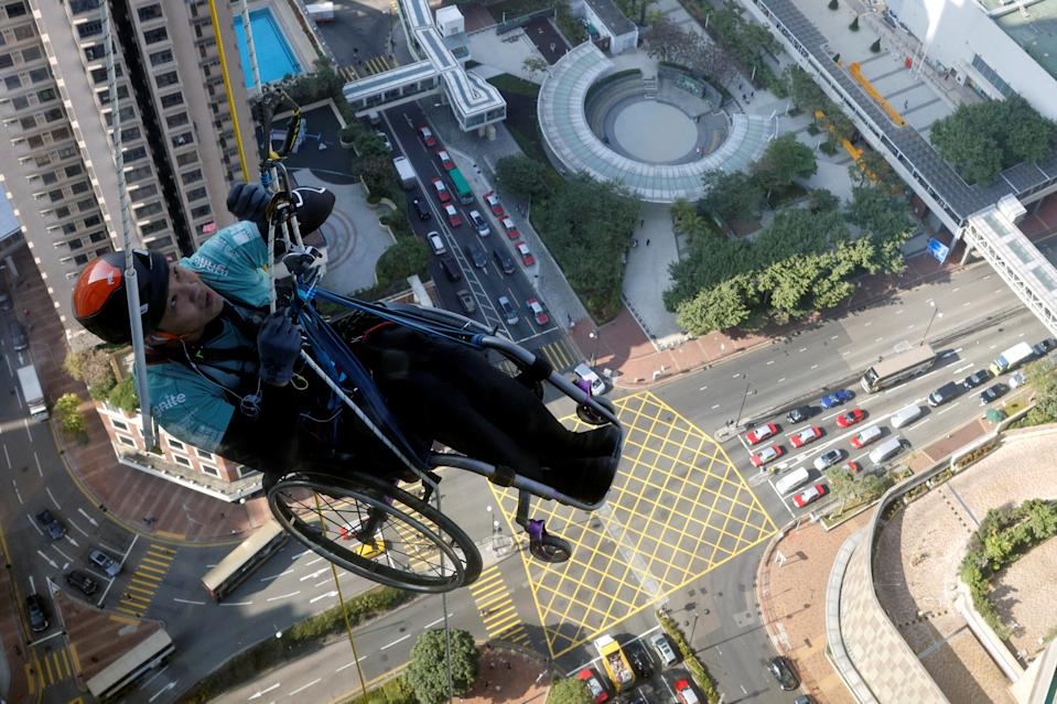Lai Chi-wai, a paraplegic climber, attempts to climb the 320-metre tall Nina Tower using only his upper body strength, in Hong Kong, China January 16, 2021. On this attempt, Lai completed 250-meters (75/f), as he faced strong winds. Picture taken January 16, 2021. REUTERS/Tyrone Siu TPX IMAGES OF THE DAY