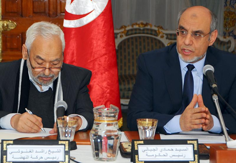 Tunisian Prime Minister Hamadi Jebali, right, is pictured with Ennahda party leader Rached El Ghannouchi at the opening of a meeting with representatives of all Tunisian political parties, to see if there is sufficient support for his solution to end the country's ongoing political crisis in Carthage, outside Tunis, Monday, Feb. 18, 2013. Jebali's initiative, while supported by the opposition, puts him on a collision course with the moderate Islamist Ennahda Party which dominates the government. (AP Photo/Hassene Dridi)