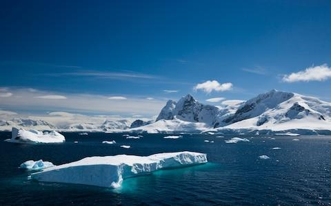 A tabular iceberg floating within Paradise Harbour, Antarctica - Credit: iStock