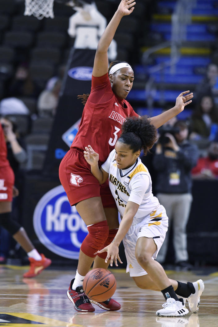 Northern Kentucky guard Ivy Turner (2) tries to fight through the defense of Louisville forward Bionca Dunham (33) during the second half of an NCAA college basketball game in Highland Heights, Ky., Sunday, Dec. 8, 2019. Louisville won 85-57. (AP Photo/Timothy D. Easley)