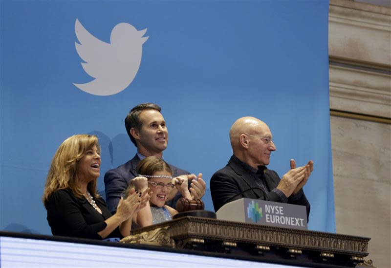 Actor Stewart, Cutler and Boston police officer Fiandaca look on during the Twitter Inc. IPO in New York