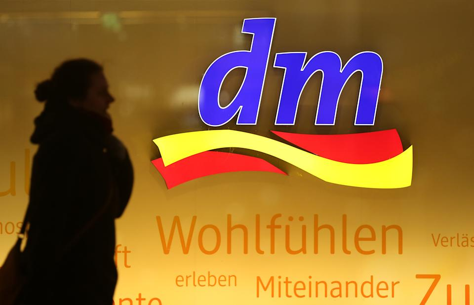 BERLIN, GERMANY - JANUARY 08:  A woman walks past a store of German drugstore retailer DM at Alexanderplatz on January 8, 2018 in Berlin, Germany. Much of the German consumer goods and foodstuffs economy is dominated by nationwide chains.  (Photo by Sean Gallup/Getty Images)