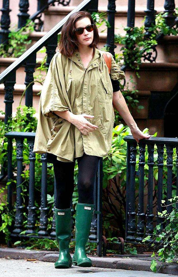 "Liv Tyler's pale chartreuse coat was as drab as the New York weather. Luckily, she was prepared with her green galoshes. Hector Vallenilla/<a href=""http://www.pacificcoastnews.com/"" target=""new"">PacificCoastNews.com</a> - September 26, 2008"