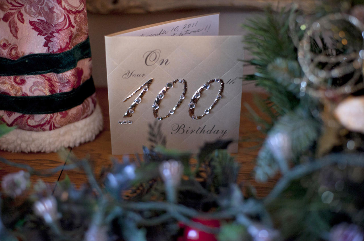 In this Dec. 28, 2011 photo, a birthday card celebrating Minka Disbrow's 100th birthday is seen in her apartment in San Clemente, Calif. Disbrow, who was raped at age 16, has lived to be 100 - long enough to meet the daughter she gave up at birth 77 years earlier and learn about the six grandchildren she didn't know she had. One of them is a space shuttle astronaut. (AP Photo/Jae C. Hong)