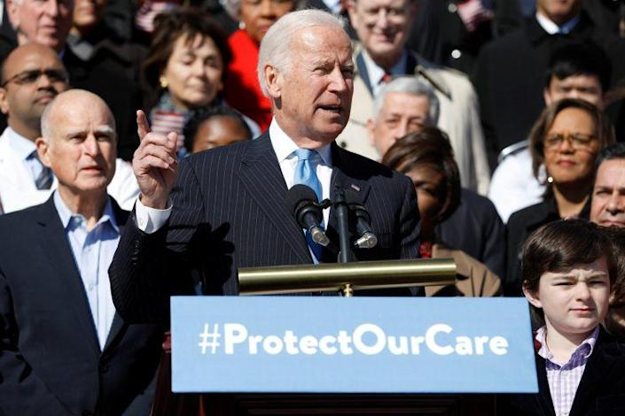 Former Vice President Joe Biden speaks at an event marking the seventh anniversary of the passing of the Affordable Care Act.