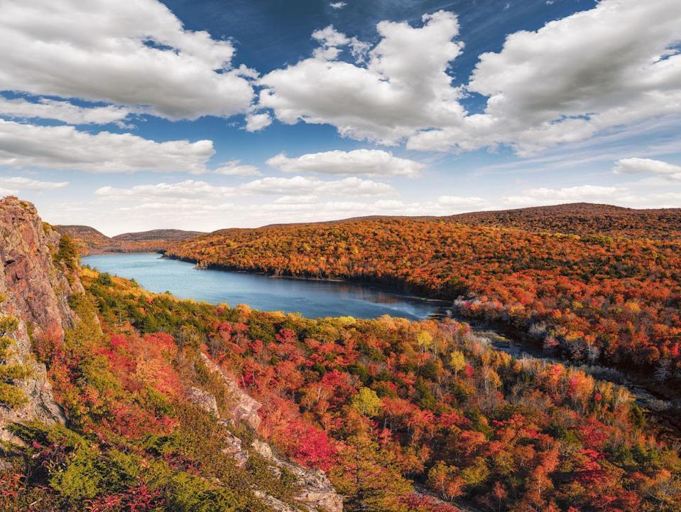 """<p><strong>Where to go:</strong> The undisturbed hardwood forests in the Upper Peninsula's <a href=""""https://www.michigan.gov/dnr/0,4570,7-350-79133_79200_31427-54024--,00.html"""" rel=""""nofollow noopener"""" target=""""_blank"""" data-ylk=""""slk:Porcupine Mountains"""" class=""""link rapid-noclick-resp"""">Porcupine Mountains</a> do not disappoint. An overlook view of the hemlocks and maples bursting into color alongside the Lake of the Clouds will satisfy your fall fix. </p><p><strong>When to go: </strong>Late October</p><p><a class=""""link rapid-noclick-resp"""" href=""""https://go.redirectingat.com?id=74968X1596630&url=https%3A%2F%2Fwww.tripadvisor.com%2FHotels-g5414977-Upper_Peninsula_Michigan-Hotels.html&sref=https%3A%2F%2Fwww.redbookmag.com%2Flife%2Fg34045856%2Ffall-colors%2F"""" rel=""""nofollow noopener"""" target=""""_blank"""" data-ylk=""""slk:FIND A HOTEL"""">FIND A HOTEL</a></p><p><strong>RELATED: <a href=""""https://www.goodhousekeeping.com/life/travel/g4246/underrated-attractions-by-state/"""" rel=""""nofollow noopener"""" target=""""_blank"""" data-ylk=""""slk:50 Most Underrated Attractions in Every State"""" class=""""link rapid-noclick-resp"""">50 Most Underrated Attractions in Every State</a></strong></p>"""