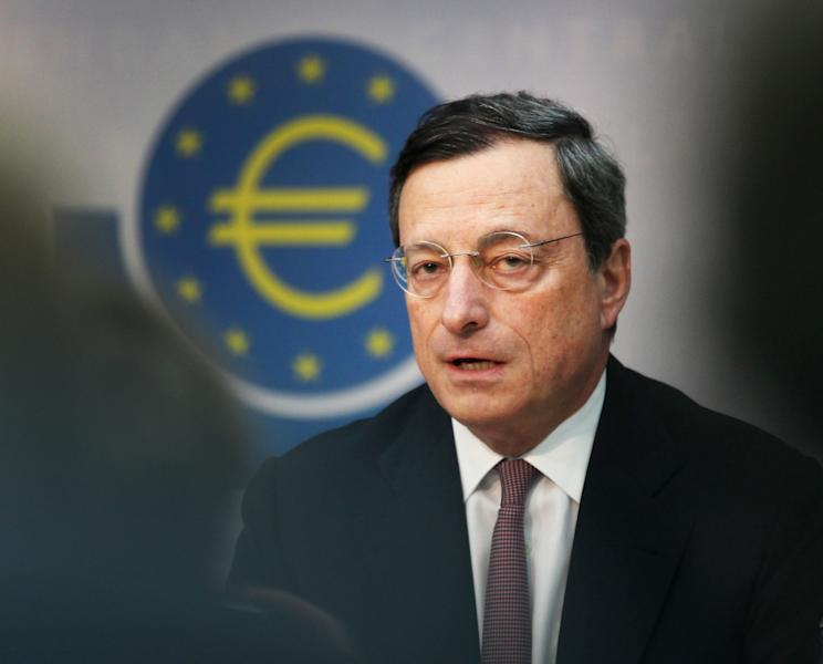 President of European Central Bank Mario Draghi speaks during a press conference in Frankfurt, Germany, Thursday, July 5, 2012. The European Central Bank has cut its key interest rate by a quarter percentage point to a record low of 0.75 percent to boost a eurozone economy weighed down by the continent's crisis over too much government debt. The move followed a rate cut by China's central bank and new stimulus measures by the Bank of England as global financial authorities seek to shore up a slowing global economy. European leaders last week agreed on new steps to strengthen market confidence in their shared euro currency bloc. They agreed to set up a single banking supervisor to keep bank bailouts from bankrupting countries and made it easier for troubled countries to get bailout help. Those steps helped calm financial markets, which have expected the ECB to follow up with more help in the form of a rate cut. (AP Photo/Michael Probst)