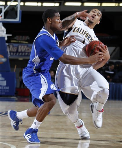 California guard Justin Cobbs, right, is fouled by Drake guard Richard Carter, left, during the first half of their NCAA college basketball game in the first round of the DirecTV Classic in Anaheim, Calif., Thursday, Nov. 22, 2012. (AP Photo/Alex Gallardo)