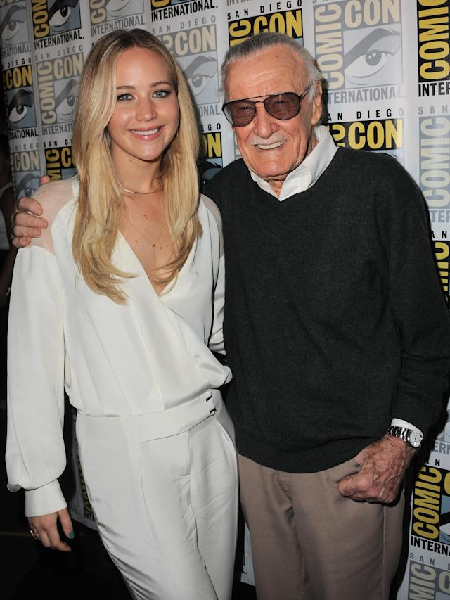 """<p>After appearing on panels for her two big franchise films — <i>The Hunger Games </i>and <i>X-Men</i> — Lawrence poses with comic-book legend and <i>X-Men</i> co-creator <a href=""""https://www.yahoo.com/entertainment/tagged/stan-lee"""" data-ylk=""""slk:Stan Lee"""" class=""""link rapid-noclick-resp"""">Stan Lee</a> on July 11, 2015. (Photo: Getty Images) </p>"""