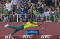 South Africa's Temba Bavuma dives as he attempts a catch during the 2nd T20 cricket match between South Africa and England at Kingsmead stadium in Durban, South Africa, Friday, Feb. 14, 2020. (AP Photo/Themba Hadebe)