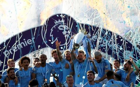 Manchester City lift the title at Brighton - Credit: Reuters