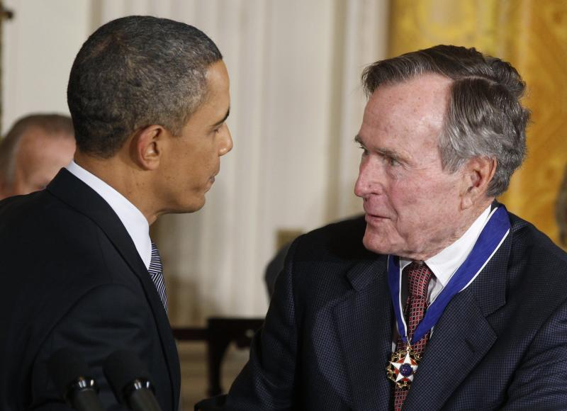 U.S. President Barack Obama congratulates Medal of Freedom recipient and former U.S. President George H.W. Bush during a ceremony to present the awards, Feb. 15, 2011. (Kevin Lamarque / Reuters)