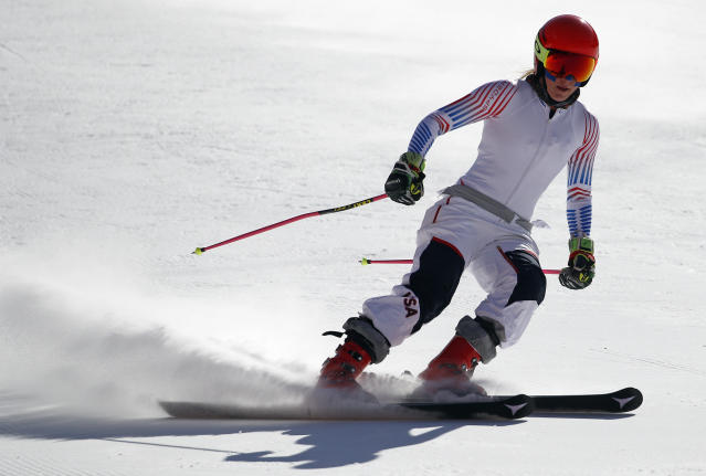 Mikaela Shiffrin will have to wait until Friday to ski the slalom, her best event. (AP Photo/Christophe Ena)
