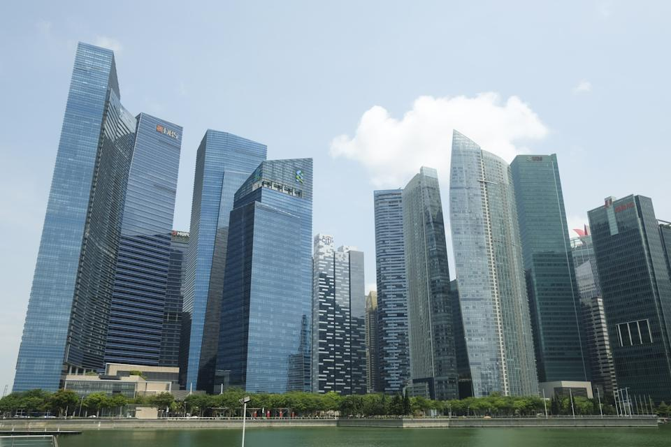 SINGAPORE - JULY 21: A view of the DBS Bank headquarters (2nd L) and Standard Chartered corporate office at Marina Bay Financial Centre, Singapore on July 21, 2019. (Photo by Adli Ghazali/Anadolu Agency via Getty Images)