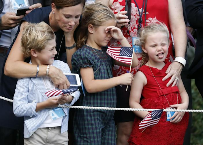 <p>Children react to the rotor wash of the helicopter as it lands on the South Lawn of the White House, Wednesday, July 12, 2017, in Washington. Marine One will take President Donald Trump from the White House for his departure aboard Air Force One. Trump is headed to Paris for Bastille Day. (Photo: Alex Brandon/AP) </p>