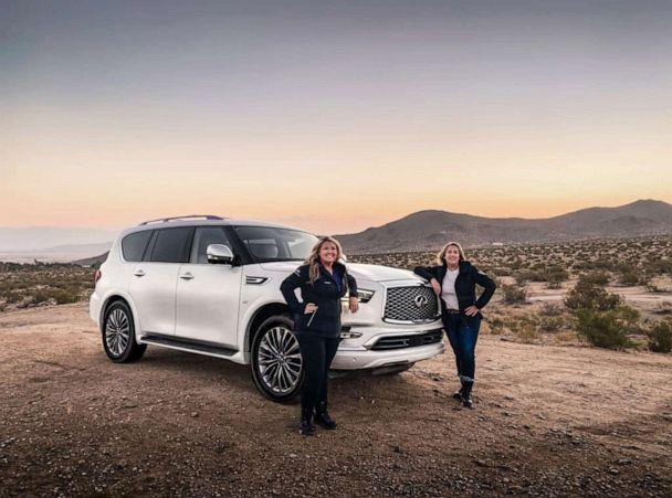 PHOTO: Alice Chase, left, and Nicole Wakelin, right, pose with the Infiniti QX80 SUV they will pilot at this year's Rebelle Rally. (Courtesy of the Rebelle Rally)
