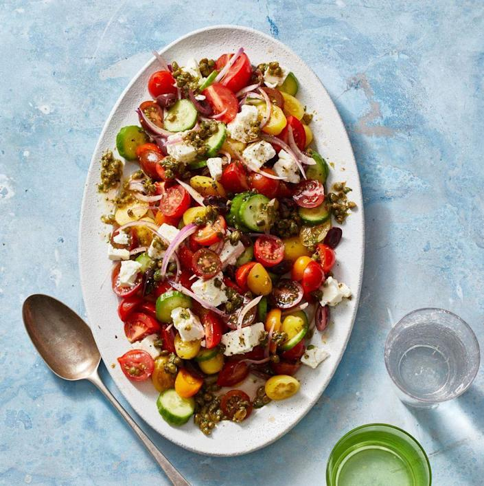 """<p>It's one of the only salads that feel like a complete meal on it's own: A medley of tomatoes and fresh cucumbers alongside creamy feta cheese make this Greek salad feel simply bountiful.</p><p><em><a href=""""https://www.goodhousekeeping.com/food-recipes/healthy/a31914743/greek-salad-recipe/"""" rel=""""nofollow noopener"""" target=""""_blank"""" data-ylk=""""slk:Get the recipe for Greek Salad »"""" class=""""link rapid-noclick-resp"""">Get the recipe for Greek Salad »</a></em></p>"""