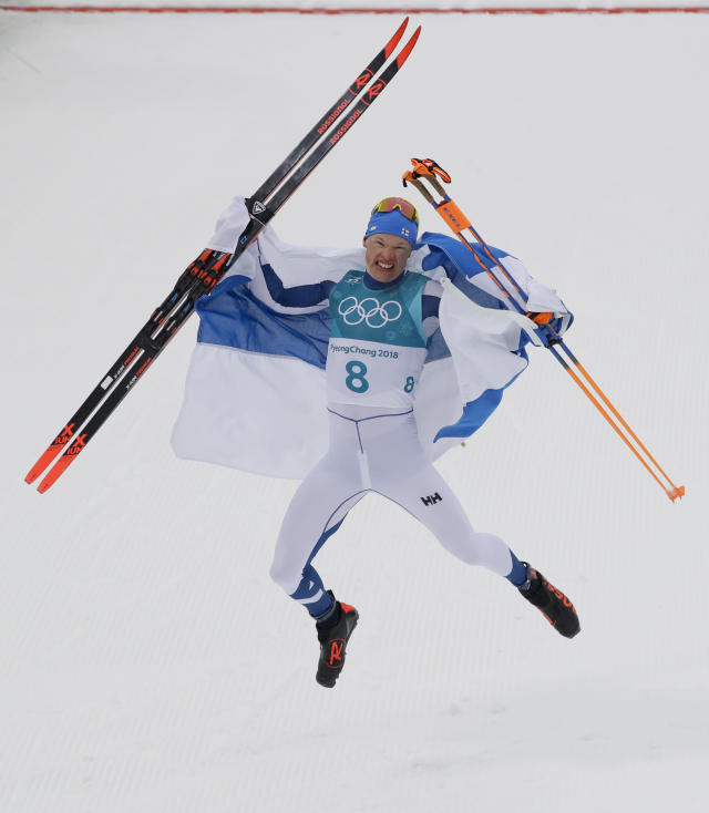 Iivo Niskanen, of Finland, celebrates after winning the gold medal in the men's 50k cross-country skiing competition at the 2018 Winter Olympics in Pyeongchang, South Korea, Saturday, Feb. 24, 2018. (AP Photo/Kirsty Wigglesworth)
