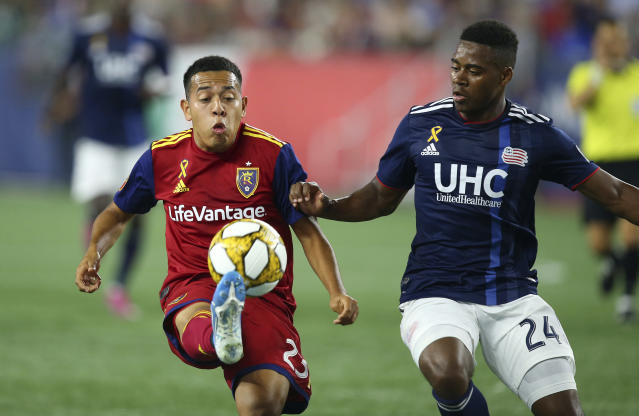 Real Salt Lake midfielder Sebastian Saucedo (23) controls the ball as New England Revolution midfielder DeJuan Jones (24) defends during the first half of an MLS soccer match at Gillette Stadium, Saturday, Sept. 21, 2019, in Foxborough, Mass. (AP Photo/Stew Milne)
