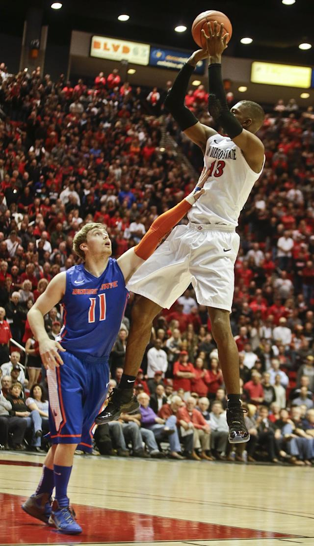 San Diego State forward Winston Shepard shoots over Boise State guard Jeff Elorriaga during the first half of a NCAA college basketball game Wednesday, Jan. 8, 2014, in San Diego. (AP Photo/Lenny Ignelzi)