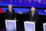 Democratic presidential candidate former Vice President Joe Biden, left, watches as Sen. Bernie Sanders, I-Vt., answers a question Tuesday, Jan. 14, 2020, during a Democratic presidential primary debate hosted by CNN and the Des Moines Register in Des Moines, Iowa. (AP Photo/Patrick Semansky)
