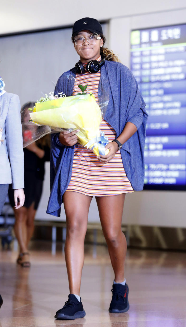 Japan's Naomi Osaka arrives at Haneda airport in Tokyo. Osaka defeated Serena Williams of the U.S. on Saturday, Sept. 8, to become the first Grand Slam singles champion from Japan.(Yohei Fukai/Kyodo News via AP)