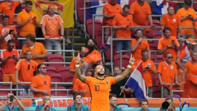 Memphis Depay celebrates after putting Holland ahead against Austria from the penalty spot