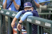 Chicago Cubs bench coach Andy Green, wearing a face mask, looks out of from dugout before a baseball game against the Pittsburgh Pirates Friday, Sept. 3, 2021, in Chicago. Green will skipper the team since manager David Ross and president of baseball operations Jed Hoyer have tested positive for COVID-19. (AP Photo/Charles Rex Arbogast)