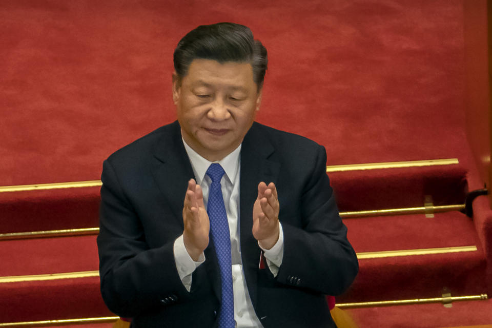 FLE - In this May 28, 2020, file photo, Chinese President Xi Jinping applauds during the closing session of China's National People's Congress (NPC) in Beijing. The ruling Communist Party is celebrating the official end of extreme poverty in China with a propaganda campaign that praises Xi's role, part of efforts to cement his image as a history-making leader who is reclaiming his country's rightful place as a global power. (AP Photo/Mark Schiefelbein, File)
