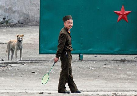 FILE PHOTO: A North Korean soldier holds a badminton racket on the banks of Yalu River near the North Korean town of Sinuiju, opposite the Chinese border city of Dandong, May 20, 2011. REUTERS/Jacky Chen/File Photo