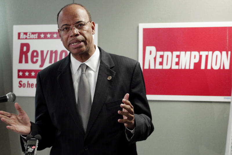 FILE - In this Nov. 28, 2012 file photo taken in Chicago, former Congressman Mel Reynolds announces that he's joining the increasingly crowded field running for the U.S. congressional seat vacated by Jesse Jackson. Jr. Reynolds is vying for an endorsement from Cook County Democratic Party officials during a slating meeting that will be held Saturday, Dec. 13, 2012 in  South Holland, ill. Reynolds is hoping for the party's endorsement that could be particularly valuable in the short campaign leading up to the February 26, 2012 Primary. (AP Photo/M. Spencer Green)