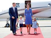 <p><strong>When:</strong> July 19, 2017 <strong>Where:</strong> Arriving at Berlin Airport on the Germany leg of a five-day tour <strong>Wearing:</strong> Catherine Walker & Co. blue coat <strong>Get the Look:</strong> Ted Baker Marsia Full Skirt Coat, $575; <span>bloomingdales.com</span> Harris Wharf London Loden Pleated Stretch Cotton-Blend Coat, $207; <span>net-a-porter.com</span> Kenneth Cole A-Line Ponte Coat, $129.90; <span>nordstrom.com</span></p>