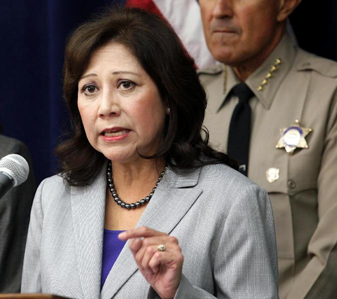 "FILE - In this Nov. 16, 2012 file photo Labor Secretary Hilda Solis speaks in Los Angeles. This is what ""Forward"" looks like. Fast forward, even. President Barack Obama's campaign slogan is springing to life in a surge of executive directives and agency rulemaking touching many of the affairs of government. They are shaping the cost and quality of health plans, the contents of the school cafeteria, the front lines of future combat, the price of coal. They are the leading edge of Obama's ambition to take on climate change in ways that may be unachievable in legislation. (AP Photo/Richard Vogel, File)"