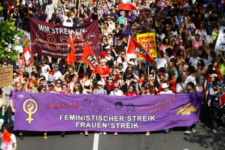 Protesters carry banners and placards at a demonstration during a women's strike (Frauenstreik) in Zurich