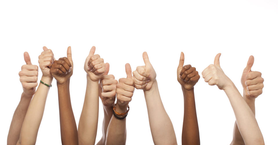 Bunch of hands raised and giving a thumbs up