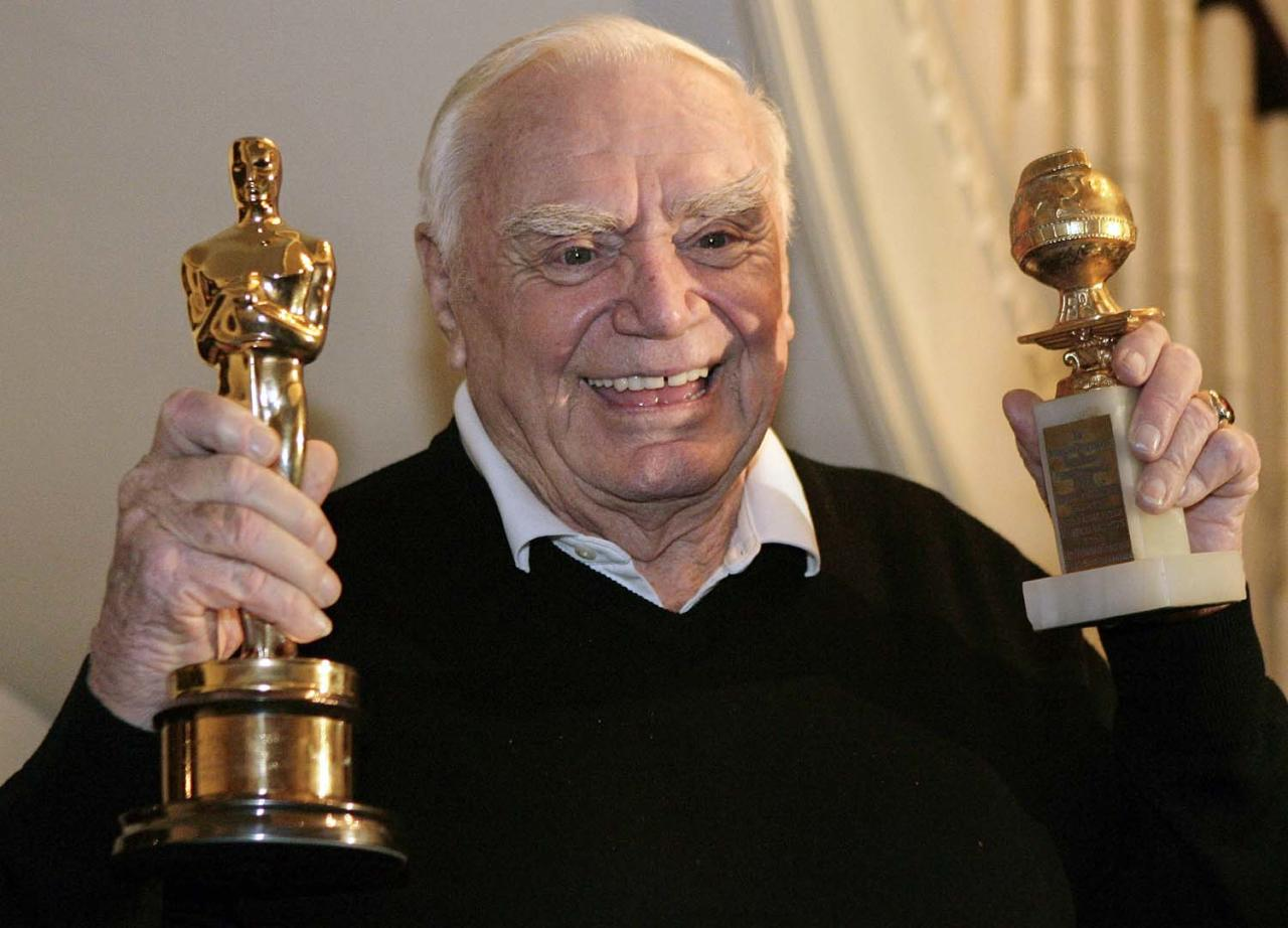 FILE - In this Jan. 13, 2008, file photo, actor Ernest Borgnine displays for a television crew, his Golden Globe, right, and Oscar awards he received in 1956 for the movie 'Marty' in Beverly Hills, Calif.  A spokesman said Sunday, July 8, 2012, that Borgnine has died at the age of 95. (AP Photo/Ric Francis, File)